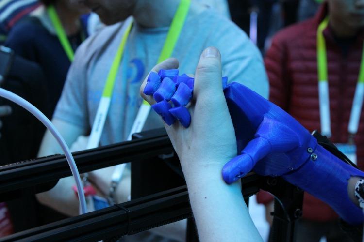 Human hand holding bionic hand
