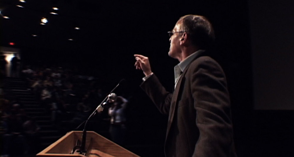 Norman debating students at the University of Waterloo