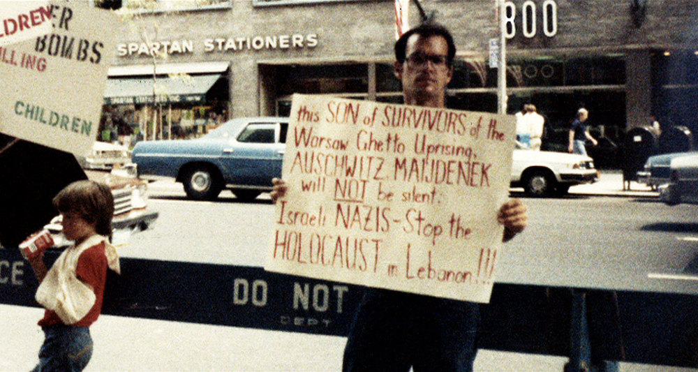 Norman holding a sign at a protest