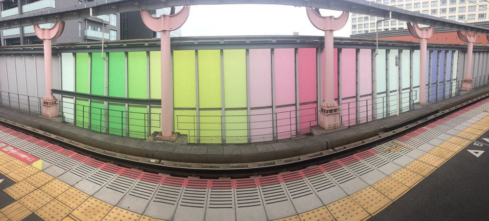 One of many colourful train stations!