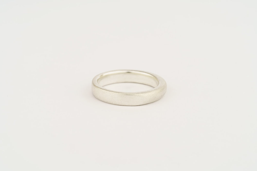 Gents' silver wedding band - half flat half round section - frosted finish