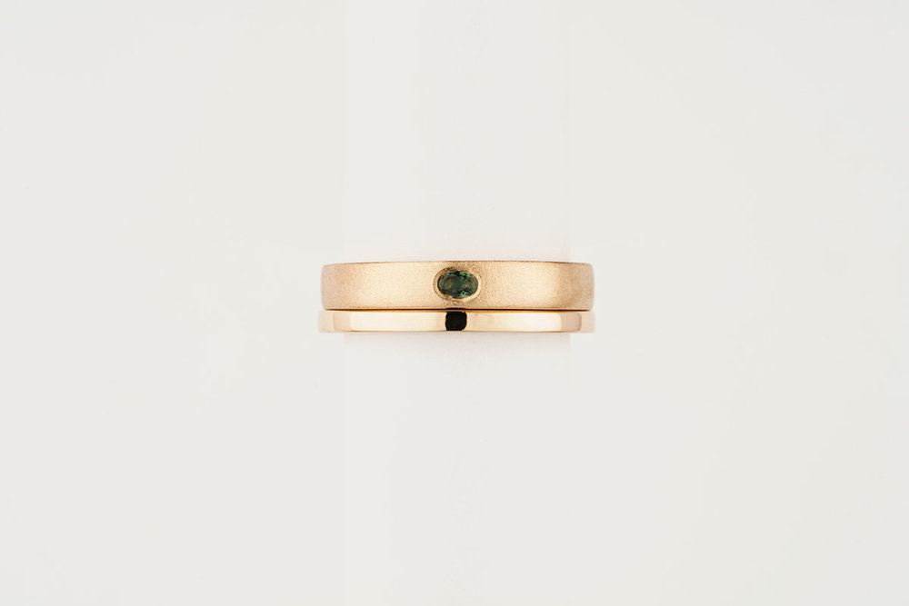9ct rose gold ring set | flush set oval green sapphire with a satin finish / polished square wedding band