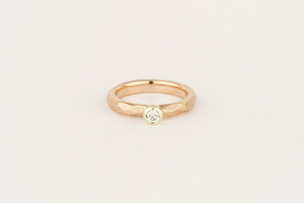 9ct rose gold / 9ct white gold textured engagement ring, set with a 0.10cts Canadamark diamond