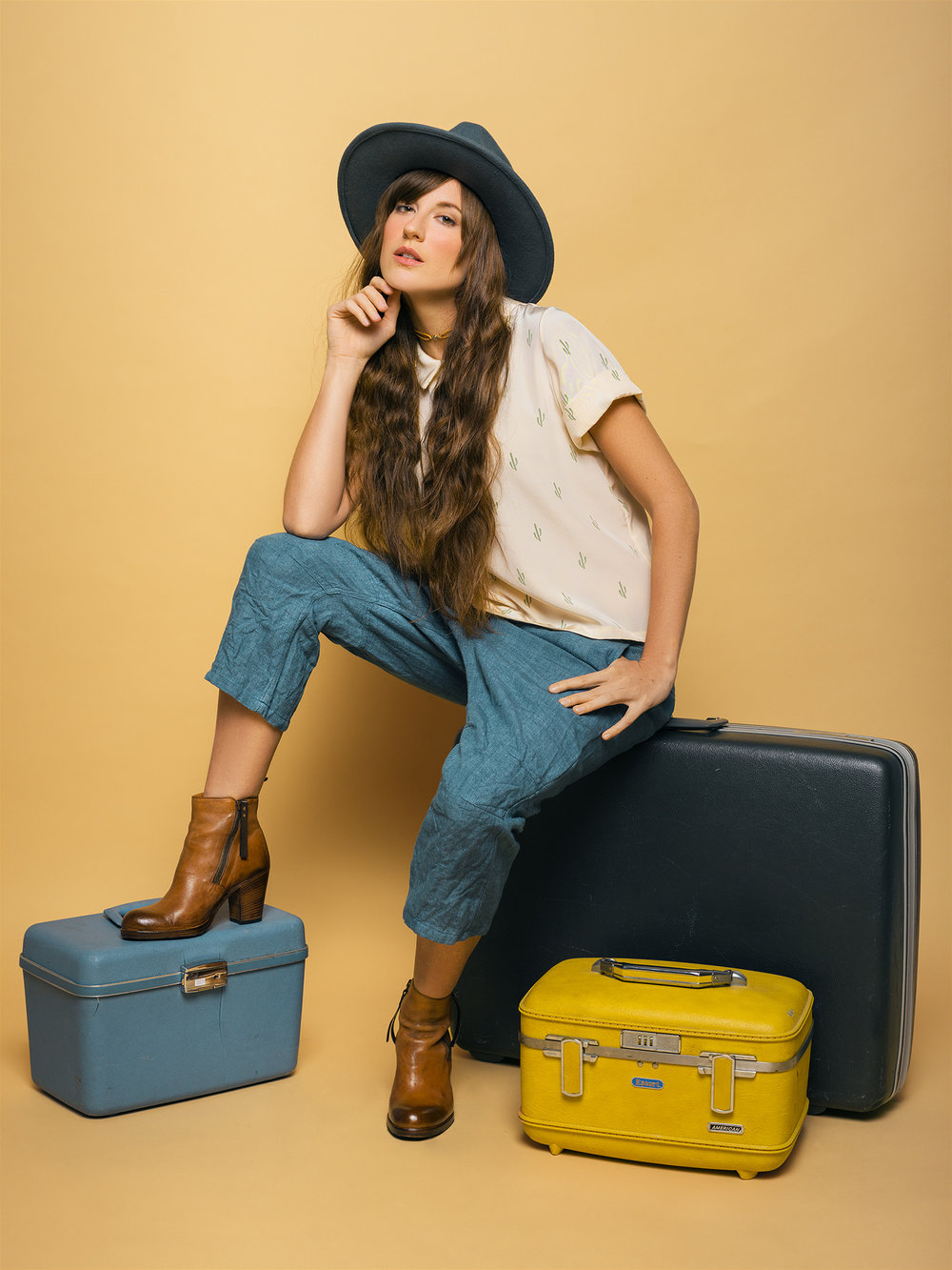 Model: Rossi Saenz  Clothing & Boots: Shop Bird Boutique  Hat: Southern Hippie  Vintage Luggage: Revival Vintage