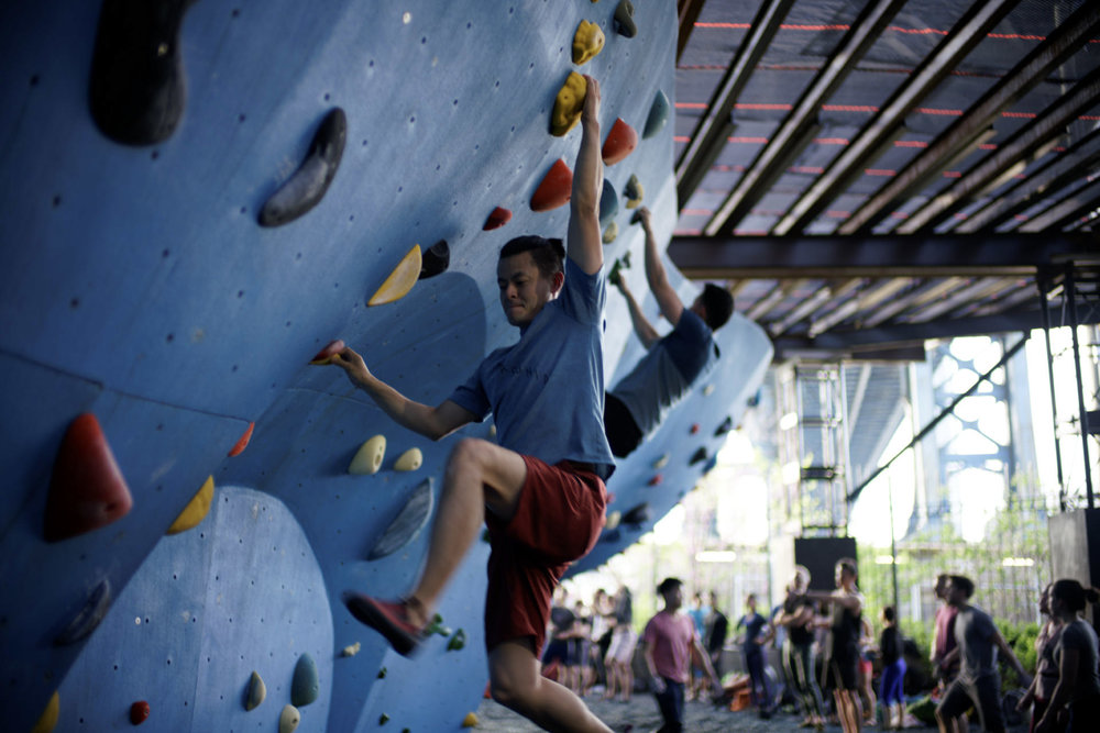 What to Wear - Any athletic wear can also be climbing wear. Some people prefer pants to protect their knees from scrapes and scuffs, but shorts are ok too. See some cool Euro style pants in a climbing video? Check out our gear shop at The Cliffs at LIC to snag a pair of your own.