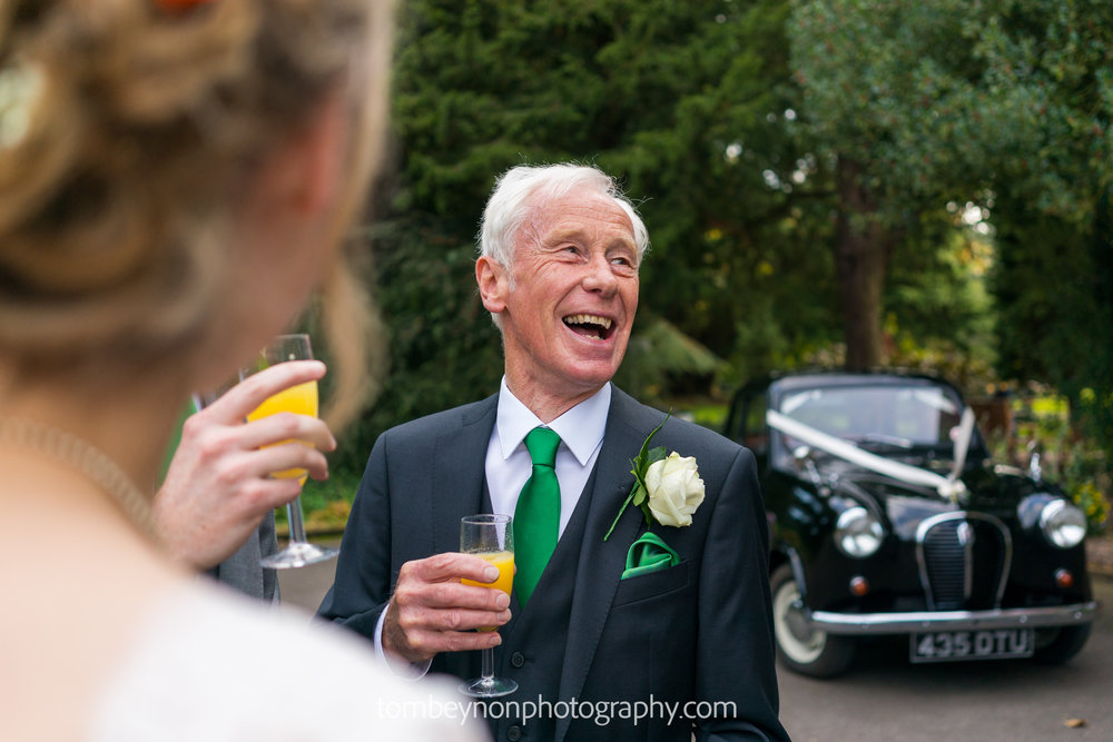 Groom's father laughing