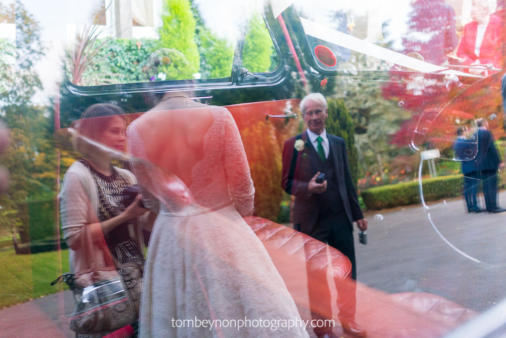 Bride's dress in car reflection