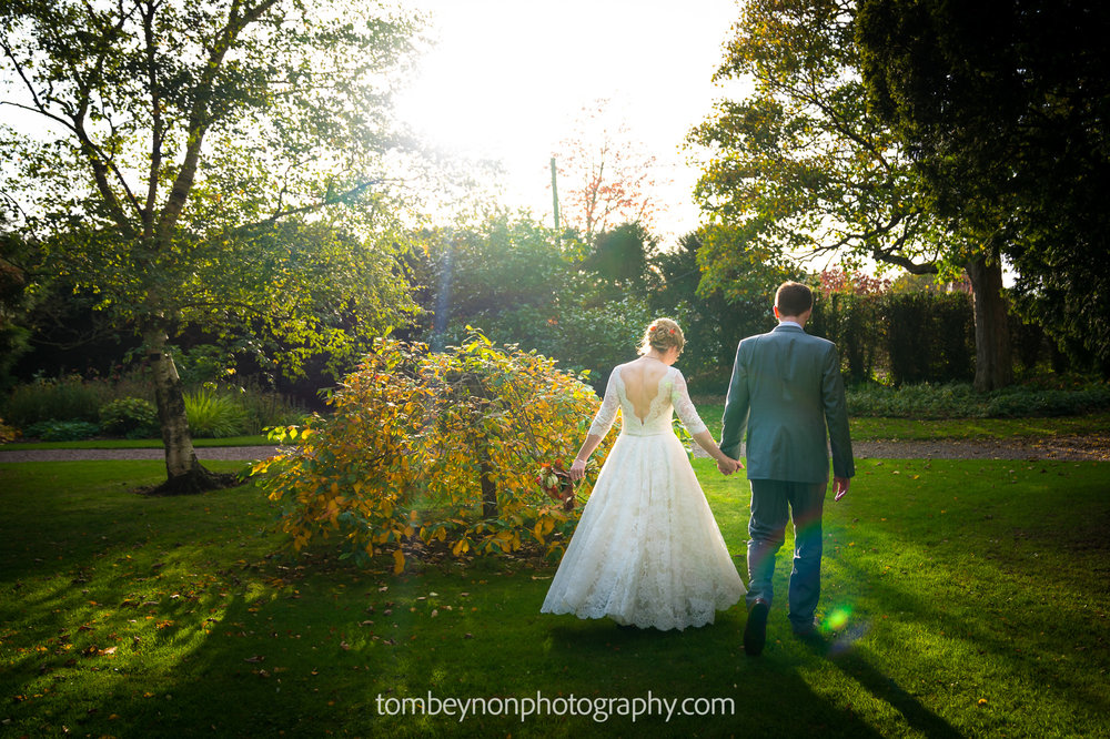 Bride and Groom go for a walk in the grounds of Rodbaston Hall