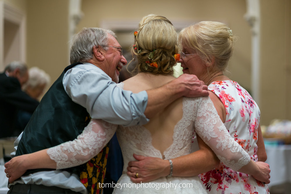 Bride enjoys time with parents
