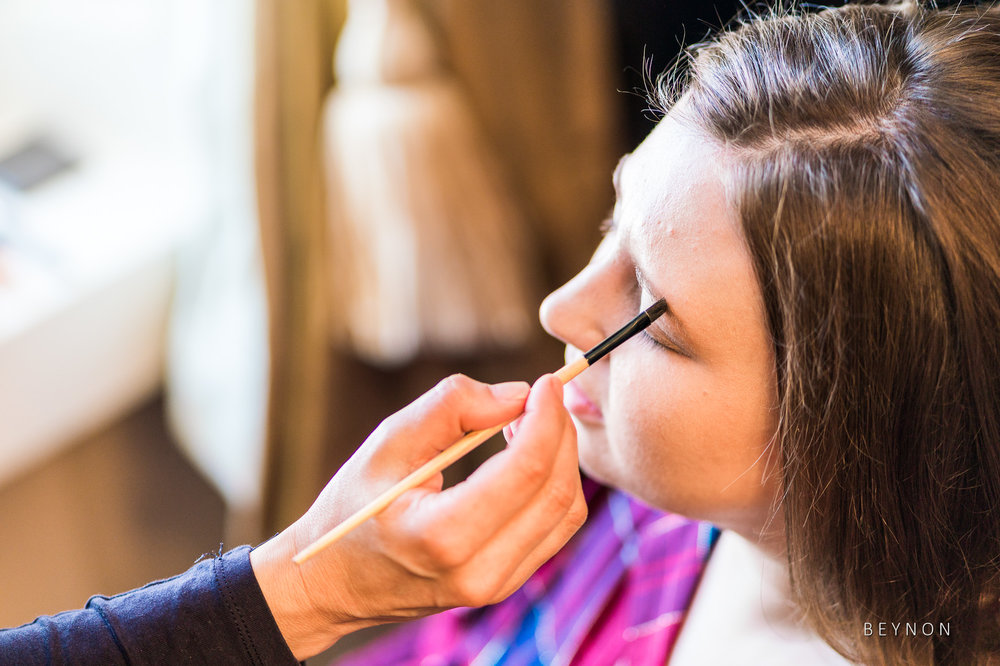 Bride gets make-up applied