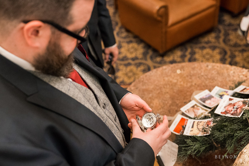 The Groom checks the time on his pocket watch