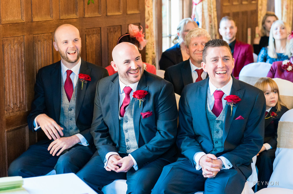Groomsmen laugh during the ceremony