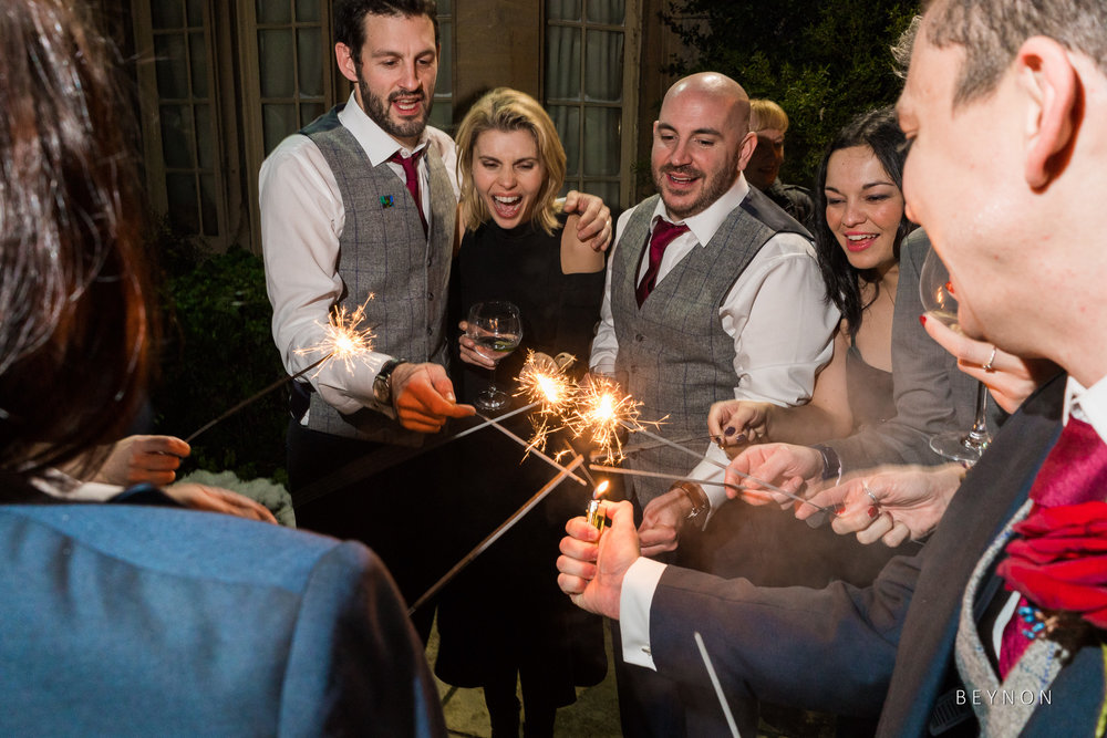 The guests light sparklers