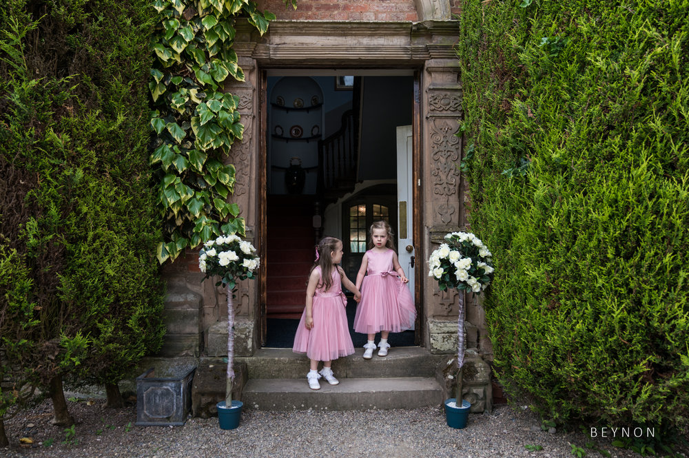 The flower girls leave for the ceremony though the main entrance at Grafton Manor