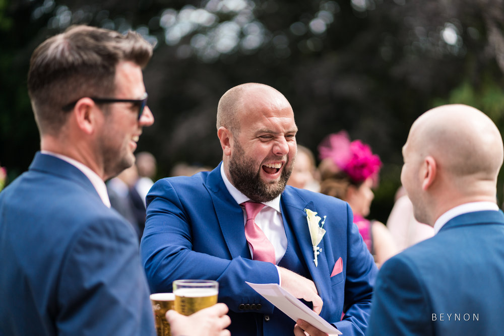 The best man laughing