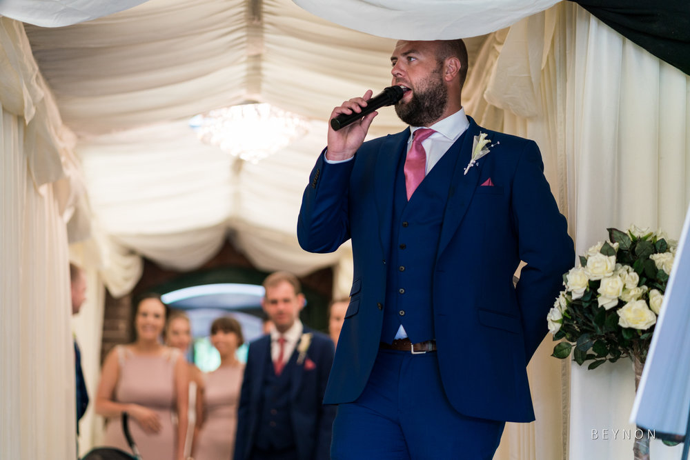 The best man announces the bridal party into the wedding breakfast