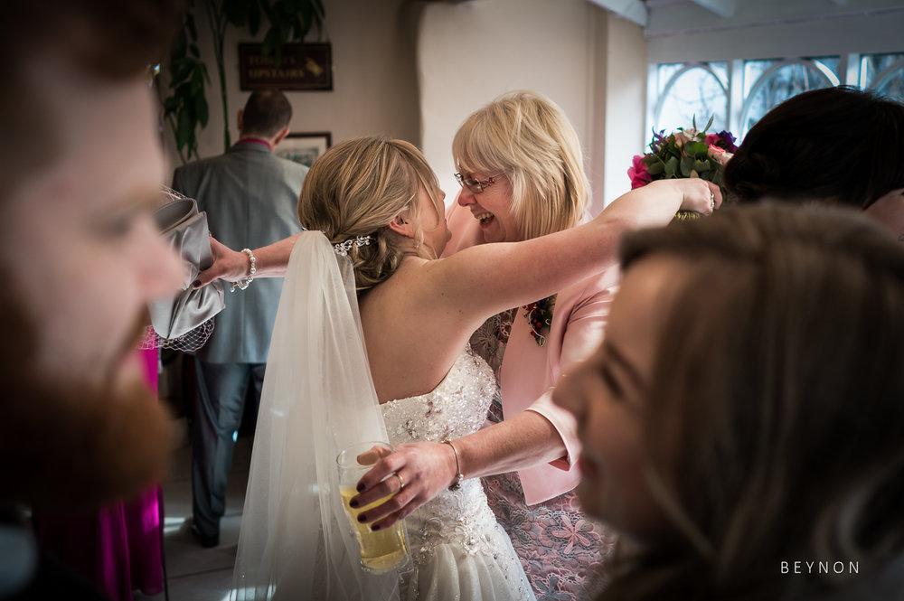 Bride hugs guest