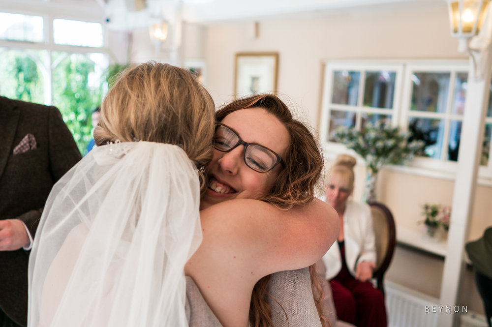 Bride hugs a friends