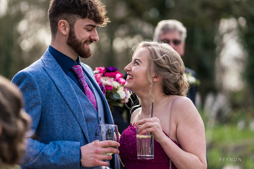 Wedding guests enjoy the spring sunshine