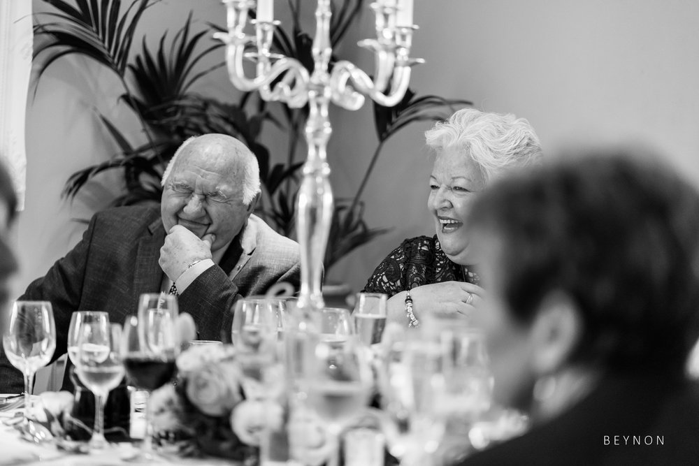 Guests laugh during speech