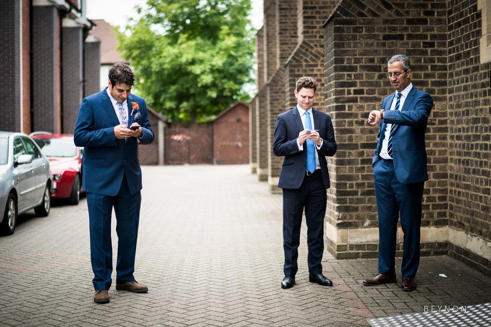 The groom checks the time