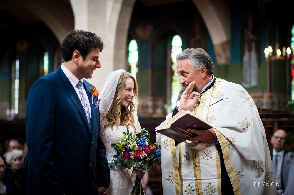 The priest talks to the happy couple