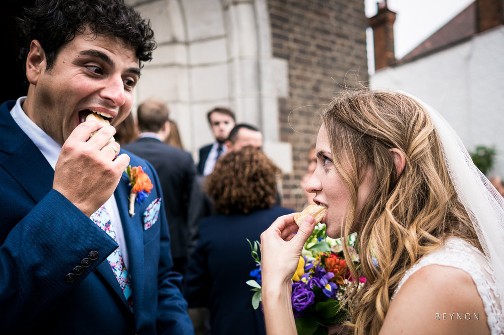 The bride and groom tuck into nibbles