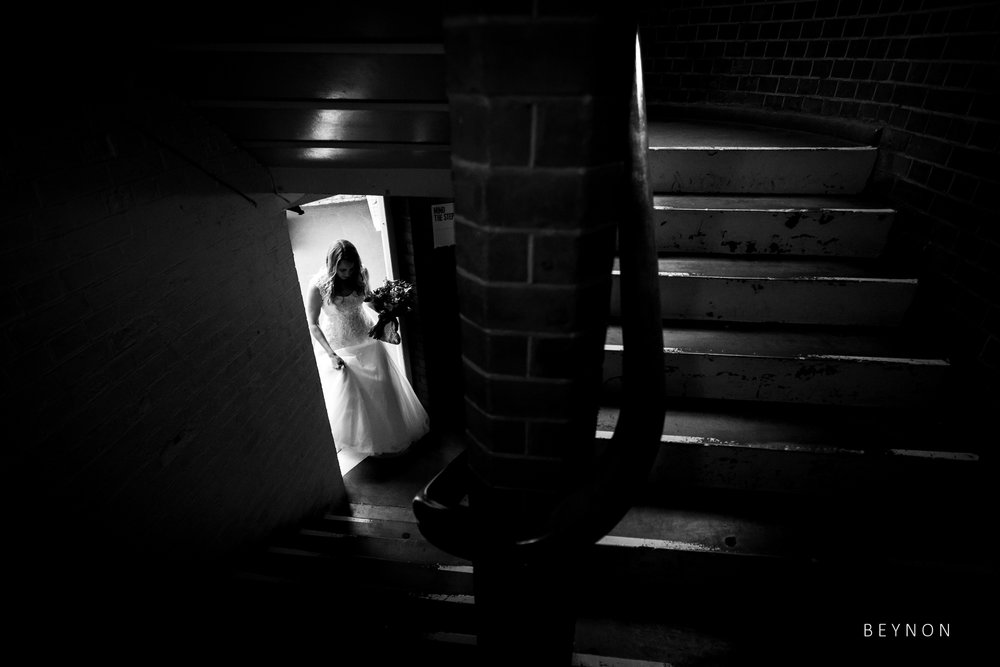 The bride walks up the stairs