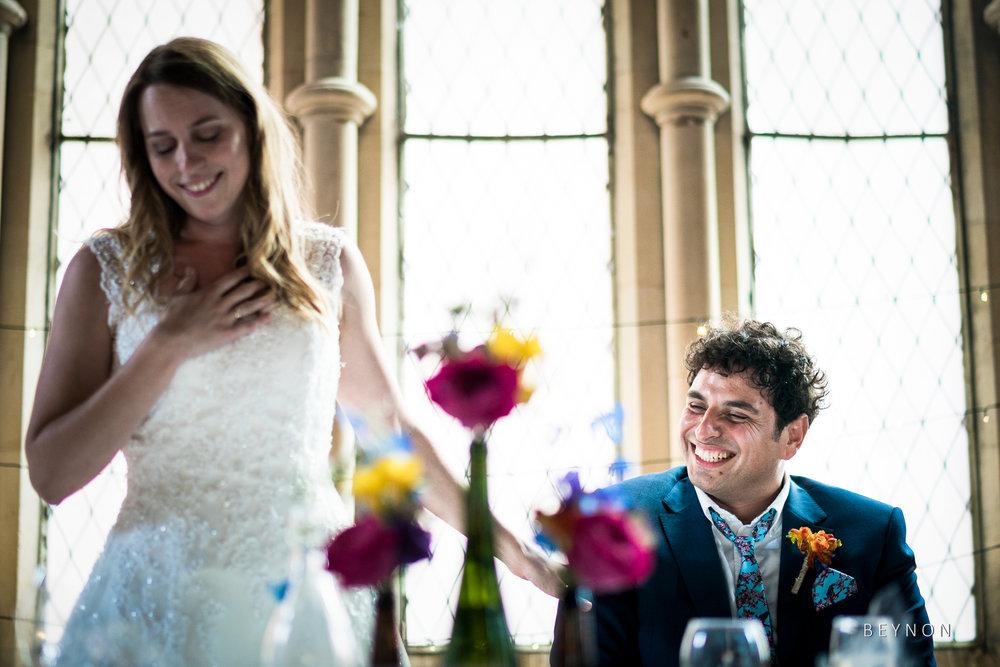 The groom smiles
