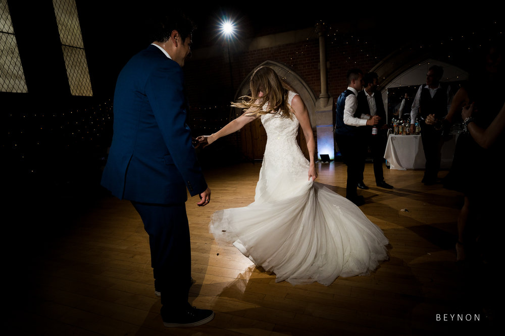 The bride swishes her dress as she dances