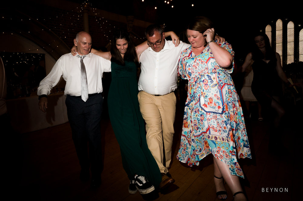 Guests dance together