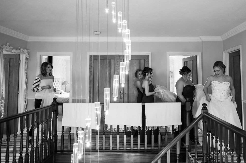The bride walks downstairs with her bridesmaids