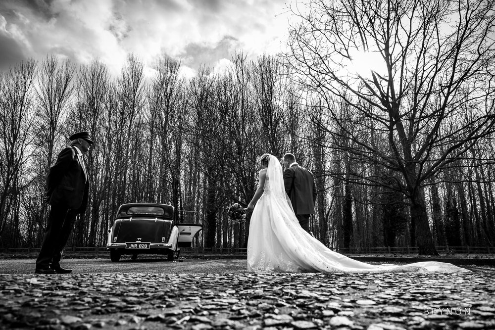 Bride and Groom walk to wedding car