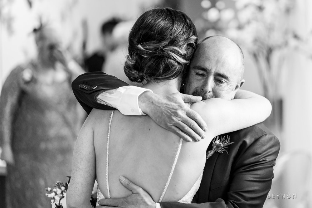 Dad and daughter hug