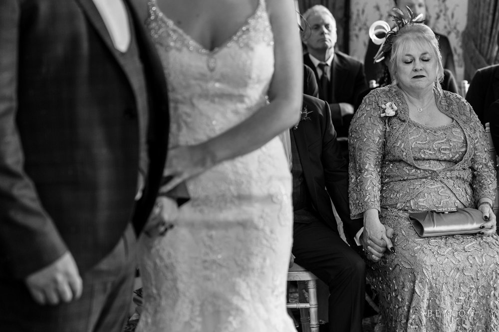Mother of the bride is emotional during wedding ceremony