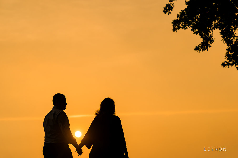 Silhouette of the bride and groom walking