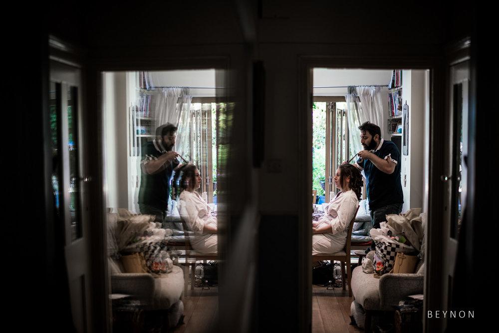 Reflection of Bride Prep in wall mirror
