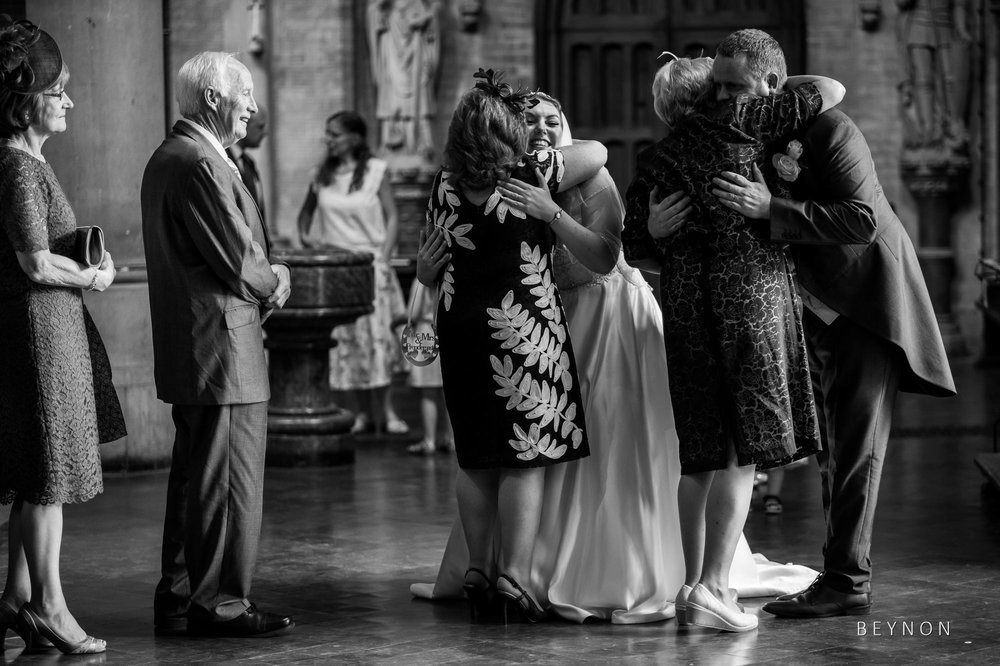 The newly weds hug guests