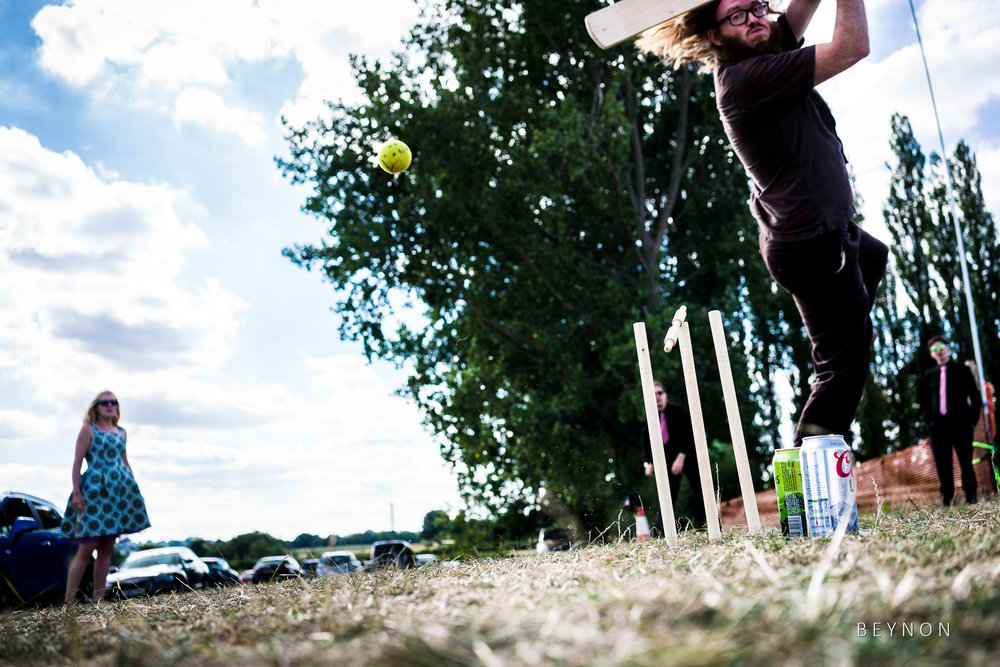 Guests play cricket during summer wedding