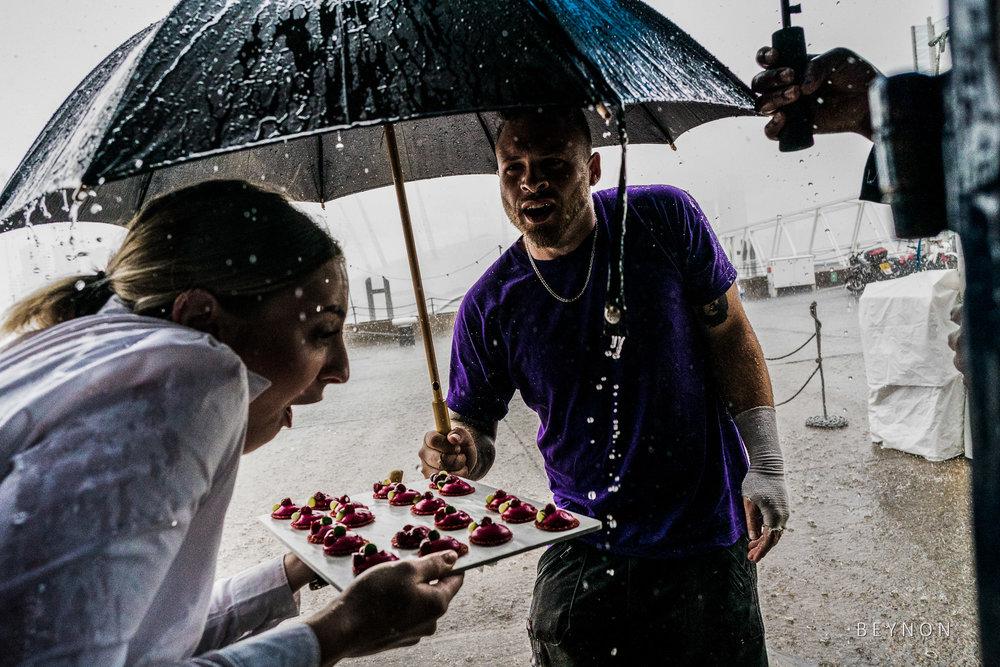 Wedding vendor tries to dodge the rain