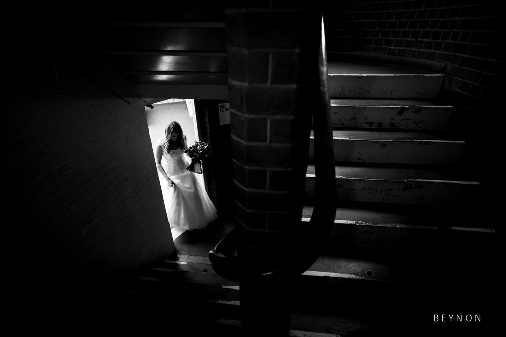 Bride about to walk upstairs
