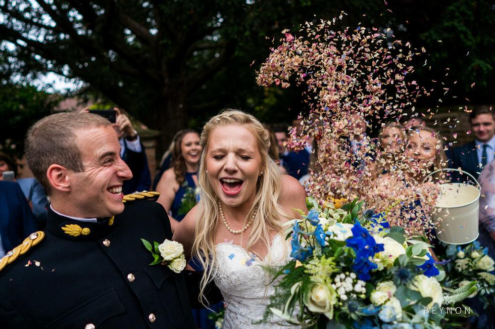 Bride has confetti toss over her
