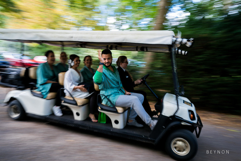 The bridesmaid's travel in a golf buggy
