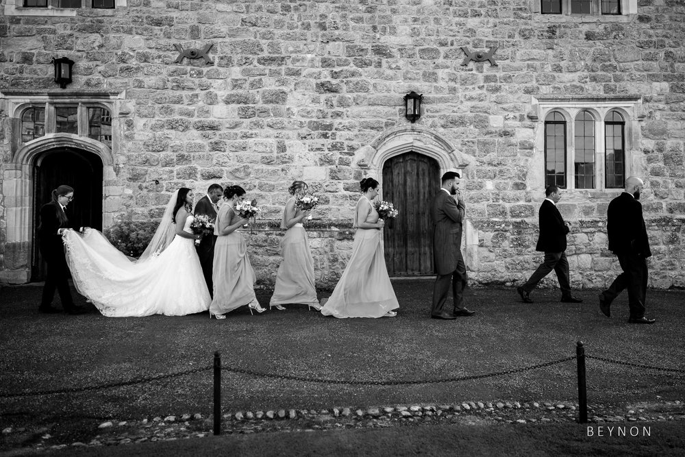 The bridal party walk to the ceremony