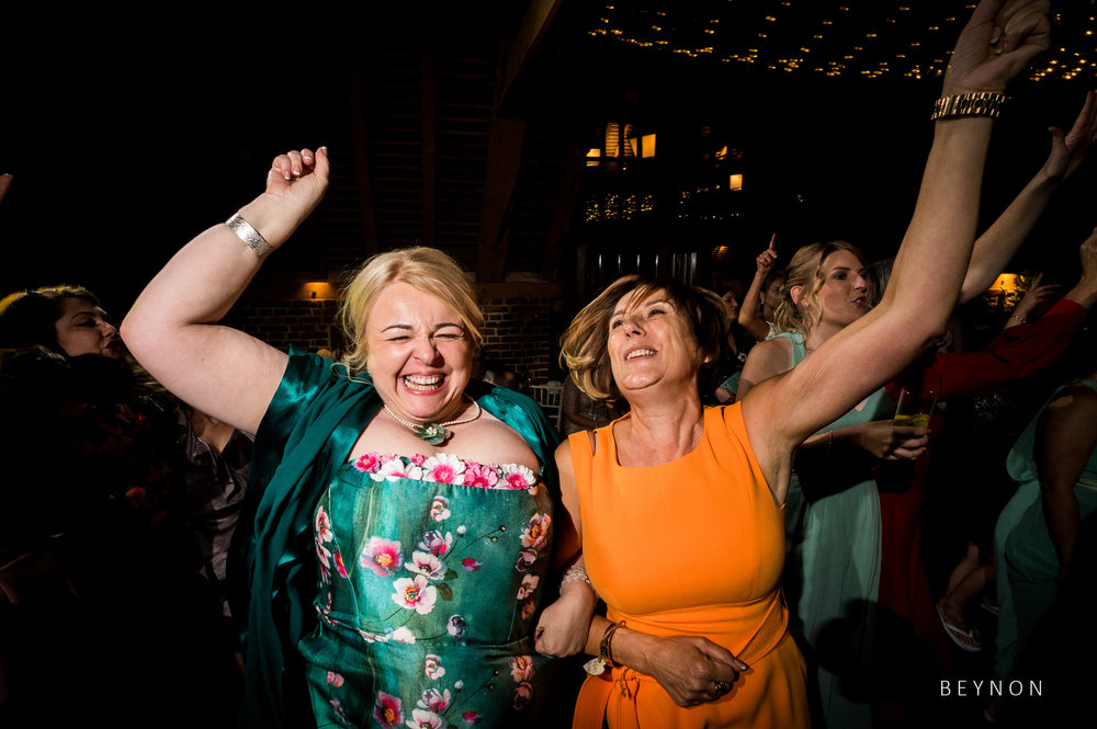 Mother of the bride and mother of the groom dance together