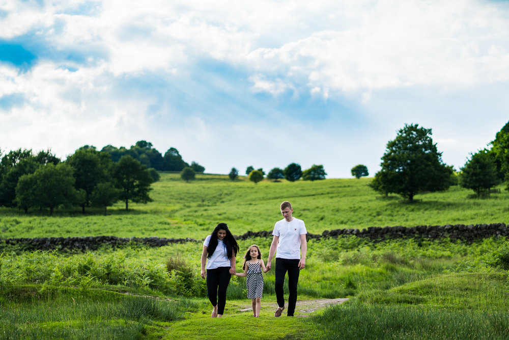 The happy couple take a walk with their daughter on thier pre-wedding shoot