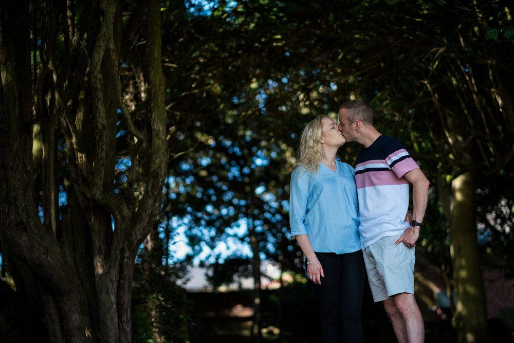 The happy couple share a kiss on their pre-wedding shoot