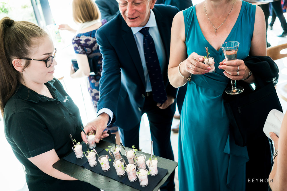 Wedding guests eat canapes