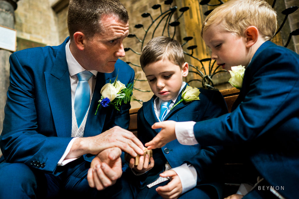 Groomsmen talks to page boys