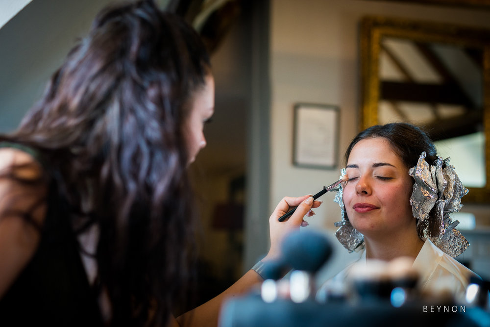 Make up is applied to bride